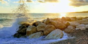 Waves crashing in at the beach of Nice