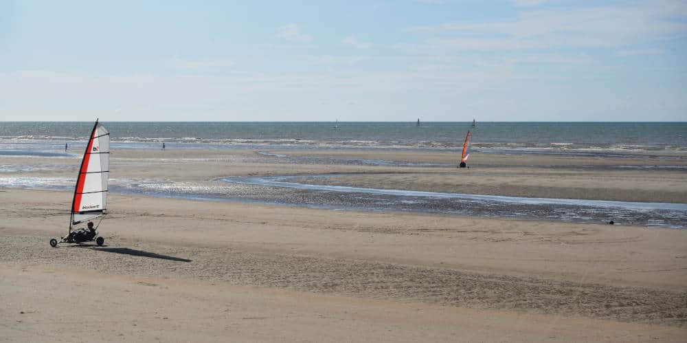Car sailing on the beach in De Panne