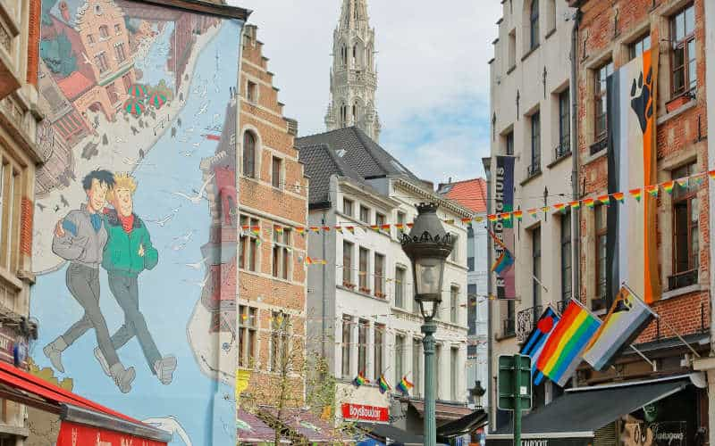 Tintin Mural painting with street cafe and tourists in Brussels