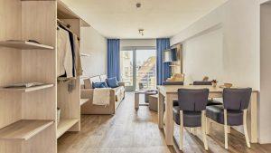 Essential Suite - 4p   Sleeping corner - Sofa bed   Balcony - City view